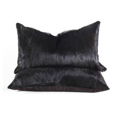 Espresso Hide Pillow - These handsome pillows are created from African Springbok hides, which have been overdyed to a very dark brown, so dark in fact that they are almost black. They are backed in dark brown fabric, fitted with a medium-fill feather and down insert and finished with a hidden zipper. Each hide is unique, please allow for variation in color and markings. Some have a fluffy spine down the center, on others it is less visible.