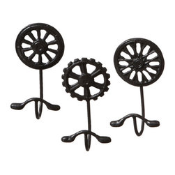 Third Gear Wall Hooks - Set of 3 - Hang your hat on wall hooks that reflect your personal style. This trio of sturdy hangers gives you an industrial touch with wheel- or gear-shaped backings and doubled hooks. Their dark, rustic finish stands out against light or medium walls.