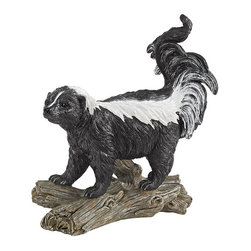 Design Toscano - Design Toscano Stinky the Striped Skunk Statue Multicolor - QL57091 - Shop for Sculptures Statues and Figurines from Hayneedle.com! You will love the reactions that the Design Toscano Stinky the Striped Skunk Statue brings out of your guests. This hand-painted skunk takes on a realistic appearance to have your guests jumping in fear. It is made from high-quality resin to withstand the elements for years to come.About Design ToscanoDesign Toscano is the country's premier source for statues and other historical and antique replicas which are available through the company's catalog and website. Design Toscano's founders Michael and Marilyn Stopka created Design Toscano in 1990. While on a trip to Paris the Stopkas first saw the marvelous carvings of gargoyles and water spouts at the Notre Dame Cathedral. Inspired by the beauty and mystery of these pieces they decided to introduce the world of medieval gargoyles to America in 1993. On a later trip to Albi France the Stopkas had the pleasure of being exposed to the world of Jacquard tapestries that they added quickly to the growing catalog. Since then the company's product line has grown to include Egyptian Medieval and other period pieces that are now among the current favorites of Design Toscano customers along with an extensive collection of garden fountains statuary authentic canvas replicas of oil painting masterpieces and other antique art reproductions. At Design Toscano attention to detail is important. Travel directly to the source for all historical replicas ensures brilliant design.