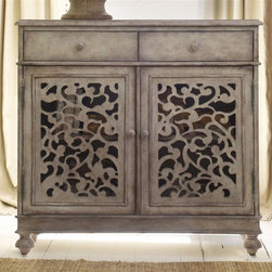 Hooker Furniture - Melange Filigree Hall Chest - Two doors with open fretwork. Adjustable storage shelf behind door. Two drawers. Full height, depth and width drawers for maximum storage capacity. Strong English or French dovetail construction. Plywood drawer bottoms attached to plywood drawer sides for strength and durability. Metal glide drawer systems operate smoothly. Made from hardwood solids and veneers. Door opening: 32.75 in. L x 10.75 in. W x 21.88 in. H. Adjustable shelf: 33.94 in. L x 9.88 in. W. Drawers: 15.25 in. W x 9.88 in. D x 3.06 in. H. Overall: 37 in. W x 13 in. D x 34.75 in. H. Assembly InstructionsThe filigree chest create airiness, light and an inviting feeling in your room. Come closer to Melange and you will discover something unexpected. An eclectic blending of colors, textures, and materials in a vibrant collection of one-of-a-kind artistic pieces, Melange is meant to inspire you and fuel an experience of self discovery, inspiring a renaissance in your home. Each piece of Melange has its own story. The designs are versatile and timeless, easily transcending from one life stage to the next, from home to home and generation to generation.