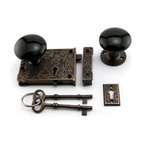 Ornate Solid Brass Rim Lock Set with Black Porcelain Knobs - Delicate in details, yet sturdy in construction, the Ornate Solid Brass Rim Lock with Black Porcelain Knobs also features intricate details and a slide bolt for privacy.