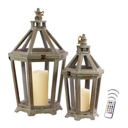 """Asian Import + USA - Bordeaux Lantern Set with Flameless Color Candles - Whether you are looking for an accent piece on your already compelling d""""cor or to add drama, this lantern may be right for your home. The dramatic wood framing allows candlelight to glow clearly from every angle. The extra large is nearly 26"""" tall and the large is 20"""" high. Included are 5"""" and 6"""" Avion Select melted edge color candles with remote control timer. Note that candles pictured are for presentation only. The candles included in the set are described above. Set of 2"""