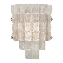 840450ST Sconce Constructivism - Sconce of individually cast Moonlit Mist clear glass pillow-shaped pieces, fused at high temperature in a hand-laid cobblestone pattern. The sole lenses create a fascinating light diffuser & sculptural form. Exposed metal in hand-applied silver leaf.
