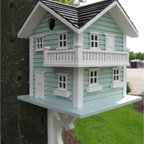 Home Bazaar Beach Haven Birdhouse - It's hard to tell if the backyard birds need a seaside vacation, but why take chances when everyone can enjoy Beach Haven Birdhouse? A soft blue finish with white trim and a black roof will make this birdhouse stand out. The included mounting bracket will give you the option of standing this birdhouse on a post or fastening it to a tree or fence. Plenty of windows and openings will give ample places to rest for wrens, chickadees, finches and nuthatches. Exterior grade plyboard and polyresin windows and ledges will weather the elements for years to come.About Home BazaarCombining their love of birds and nature with their technical and design abilities, the people of Home Bazaar set out to create the world's most spectacular line of birdhouses and birdfeeders in 1999. They've even created a line of architectural birdhouses, feeders, pedestals, and garden accessories. These items are created using only the finest materials and with painstaking attention to detail. Each product is manufactured for functional use and to be enjoyed for years. Distinctive bird houses and feeders can be matched with accommodating pedestals and these pieces can be placed in the backyard or the garden. Cottage designs and pieces with Victorian scrollwork often end up on covered porches or inside the home as decorative accents.