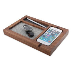 Tinsel & Timber - Timber Tray iPhone 6 Charging Station by Tinsel & Timber - Keep your new iPhone 6 safely and stylishly stowed in the Timber Tray iPhone 6 Charging Station by Tinsel & Timber. It is made out of a solid block of maple or American black walnut that is hand-finished in a protective natural oil and wax to help bring out its inherent beauty. The phone docking station and two storage trays are lined with soft 100% Merino wool. Founded in 2012, Tinsel & Timber is a Chicago-based design firm specializing in finely crafted solid wood tech accessories and furniture. With an eye always on the future, Tinsel & Timber pieces are made using only natural, sustainable materials, and with every product sold, they make a donation to the Arbor Day Foundation. All Tinsel & Timber products are designed and made by hand in the USA.