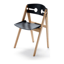 We Do Wood - We Do Wood Dining Chair No.1, Black - The chair is a simple but elegant composition of several fitted pieces. The seat is rimmed with an abrupt incline inspired by old-fashioned metal dustpans, whose form represents both strength and practical use. A rounded back with two symmetric keyhole shapes carved into the frame enhance the three dimensional experience of the chair, and add lightness and air to its feel.