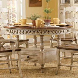 Summerglen Round Storage Dining Table - Garden-ready good looks, and classic country charm unite in the Summerglen Round Storage Dining Table. The round lattice apron top and drawer base feature a distressed off-white finish that's light and sunny. The contrasting wood top provides a beautiful and unexpected finish. A leisurely weekend breakfast, or traditional family dinner never tasted better.Not available for sale in, or delivery to, the state of California.About Hooker Furniture Corporation For 83 years, Hooker Furniture Corporation has produced high-quality, innovative home furnishings that seamlessly combine function and elegance. Today, Hooker is one of the nation's premier manufacturers and importers of furniture and seeks to enrich the lives of customers with beautiful, trouble-free home furnishings. The Martinsville, Virginia, based company specializes in lifestyle driven furnishings like entertainment centers, home office furniture, accent tables, and chairs. Construction of Hooker Furniture Hooker Furniture chooses solid woods and select wood veneers over wood frames to construct their high-quality pieces. By using wood veneer, pieces can be given a decorative look that can't be achieved with the use of solid wood alone. The veneers add beautiful accents of color and design to the pieces, and are placed over engineered wood product for strength. All Hooker wood veneers are made from renewable resources and are located primarily on the flat surfaces of the furniture, such as the case tops and sides. Each Hooker furniture piece is finished using up to 30 different steps, including 13 steps of hand-sanding and accenting. Physical distressing is done by hand. Pieces receive two to three coats of solid lacquer to create extra depth and add durability to the finish. Each case frame is assembled using strong mortise-and-tenon joints, which are then reinforced by mechanical fasteners and glue. On most designs, end panels extend to the floor to add strength and stability. Panel-style furniture features strong panel and frame construction to help avoid warping. Your Hooker furniture features finished case interiors to eliminate unsightly raw wood and to help protect items you may store inside drawers or cabinets. Drawer parts are given a urethane or lacquer finish to create smooth action and durability. All drawers use dovetails, either English or French, for years of problem-free use. Drawer bottoms are constructed from plywood and attached to the plywood drawer sides via the use of hot glue and/or wood glue blocks. Most drawers are full width, depth, and height to provide the maximum amount of storage space.