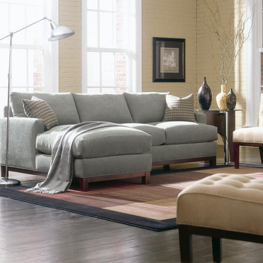 Sullivan Mini Mod Sectional Sofa - This modular sectional sofa can be rearranged to fit your living room design. Crisp contemporary lines make up the frame and cushions of the pieces and lend a clean elegant style to your living room. Loose accent pillows add an extra dose of color, texture and comfort.