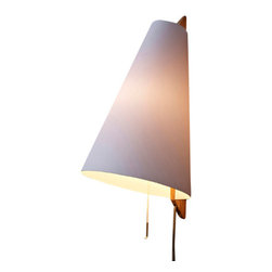 Brendan Ravenhill - Hood Sconce - This sweetly simple sconce would make a smart addition on either side of a bed. The soft glow through the polymer shade looks like it would put everyone in a flattering light — and hey, isn't that crucial for bedroom lighting?