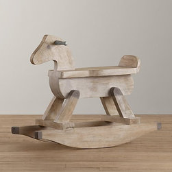 Vintage Rocking Horse - Carved out of distressed solid wood, Restoration Hardware's rocking horse has the vintage appeal of a family heirloom.
