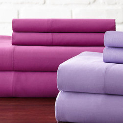 Hotel New York - Lilac & Orchid 600-Thread Count Sheet Set - For blissful nights of rest, surround yourself in the ultimate comfort of these luxurious sheets that offer a versatile look for a variety of bedding styles.   Includes two flat sheets, two fitted sheets and four pillowcases Fits mattresses up to 18'' deep 60% cotton / 40% polyester 600-thread count Machine wash Imported