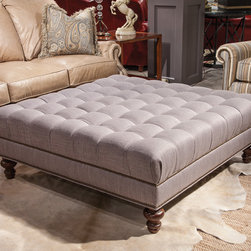 October 2014 High Point Market - This square cocktail ottoman is part of our Solutions program, where you can choose various sizes and style options to customize the look and feel of the piece to fit your home. Shown is the 2017F-55/48 with a tufted top, nailhead trim and turned leg.
