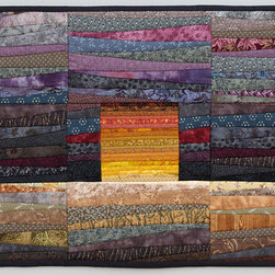 "Quilts--abstract and intense - This small quilt--""maples""--contrasts the intense piecing of the yellow maple trees against the fall horizon. It is pieced and quilted using a method I call quilt as you go using commercially available cotton fabrics. It would look great over a small buffet table or chair. Custom orders welcome. Photo by John Polak"