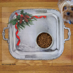 Sniff It Out Pet Mats - Holiday Silver Tray Pet Food Mat, Large - We have added a Christmas decoration to our silver tray. Which is our best selling design. Great for all of you who go all out for Christmas! Not a Metallic finish. Clear vinyl designer mat uniquely designed to resemble beautiful art painted directly onto your floor. The smoothness of the vinyl allows for easy cleanup and lays perfectly flat. Sniff It Out Pet Mats make great gifts and will be a conversation piece that your friends and family won't stop talking about. Made in the USA.