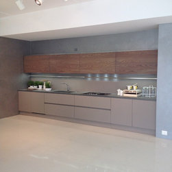 Pedini showroom tour in Italy - Frosted glass bottom cabinets and book matched upper veneer