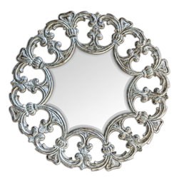 Fratelli Round Mirror - Hand Carved Teak Wood Finished In A Heavily Distressed Silver Leaf With Rust Bronze Undertones.