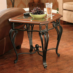 Holly & Martin - Holly & Martin Newcastle End Table - Clear tempered, beveled glass top. Black metal frame. Dark cherry trim. Made from MDF and veneer. Dark cherry and black finish. 22 in. W x 22 in. D x 23.5 in. H (33.81 lbs.). Assembly InstructionsGrace your home with the true elegance of this beautiful cocktail table. Scrolled black iron legs and a beveled glass top with dark cherry trim are combined for a truly wonderful accent piece for your home. The metal legs are hand crafted with delicate curves and symmetrical details from top to bottom. The traditional styling is timeless and with durable metal construction you are sure to enjoy such a wonderful piece for years to come.