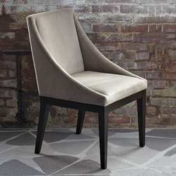New Curved Upholstered Chair - Everyday glamour made easily accessible. A curving sweep of a silhouette adds a bit of elegance to the clean, classic lines and tailored upholstery of this dining or accent chair, which comes covered in durable, stain-resistant soft velvet.