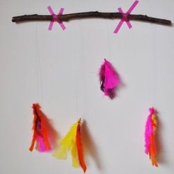 Neon Feather Mobile - Rustic meets neon on this handmade mobile. Add a little accent near the changing table for something to catch the eye while you change baby.