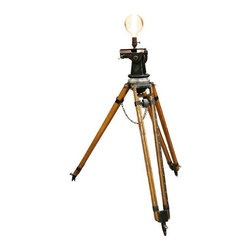 Cinematic Tripod Floor Lamp - Lights, camera, action! This vintage cinematography tripod has been wired to make the perfect industrial chic floor lamp. Stout construction, adjustable legs, and an oversized Edison bulb marry function and style.