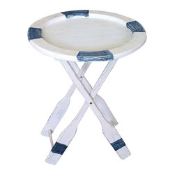 "Life Ring Table - The life ring table measures 20.5"" x 25"". It features a distressed white  blue life ring sitting atop a stand made to look like oars. It will add a definite nautical touch to wherever it is placed and is a must have for those who appreciate high quality nautical decor. It makes a great gift, impressive decoration and will be admired by all those who love the sea."