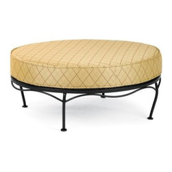 Woodard Maddox Cushion Oval Ottoman - As attractive as it is versatile, the Woodard Maddox Cushion Oval Ottoman makes a great addition to your outdoor seating area. Not only is it perfect for kicking up your heels and relaxing, the cushion makes it so comfortable that you can even seat a guest on it! You can even remove the cushion and use the ottoman top as a small table to keep snacks and beverages handy during a tete-a-tete! Characterized by clean lines and a smart, transitional design, this ottoman is constructed of fully-welded wrought iron and comes in a choice of powder-coated finishes, which will not rust, peel, or blister even after years of use. And since wrought iron furniture is heavier than aluminum, it stays put even in the face of strong winds and makes a great choice for windier locations. Made by Woodard, the leader in outdoor wrought iron furniture, this ottoman will offer years of versatile function.Important NoticeThis item is custom-made to order, which means production begins immediately upon receipt of each order. Because of this, cancellations must be made via telephone to 1-800-351-5699 within 24 hours of order placement. Emails are not currently acceptable forms of cancellation. Thank you for your consideration in this matter.Hand-crafted to Withstand the Test of TimeFor over 140 years, Woodard craftsmen have designed and manufactured products loyal to the timeless art of quality furniture construction. Using the age-old art of hand-forming and the latest in high-tech manufacturing, Woodard remains committed to creating products that will provide years of enjoyment.Superior Materials for Lasting DurabilityEach piece in the Classics Collection is hand-formed using solid wrought iron stock: the heaviest available. The technique used to create Woodard wrought iron furniture has been handed down from generation to generation. To this day, expert workers use anvils and hammers to forge intricate detail in the iron.Fabric, Finish, and Strap Features All fabric, finish, and straps are manufactured and applied with the legendary Woodard standard of excellence. Each collection offers a variety of frame finishes that seal in quality while providing color choices to suit any taste. Current finishing processes are monitored for thickness, adhesion, color match, gloss, rust-resistance, and proper curing. Fabrics go through extensive testing for durability and application, as well as proper pattern, weave, and wear.