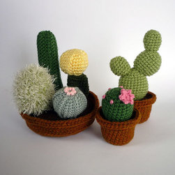 Realistic Crocheted Cacti and Succulents by Luna's Crafts - These adorable crochet cacti would add a ton of whimsy and charm to a low bookshelf or side table. Soft and squishy, they are perfect for the little hands that will undoubtably grab them.