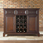 Crosley Furniture - Newport Buffet Server / Sideboard w Wine Stor - Beautiful Raised Panel Doors. Antique Brass Finish Hardware. Removable Wine Storage Panels Reveal Additional Open Storage. Adjustable Shelf Behind Each Door and in Center Section. Adjustable Levelers in. Legs. Three Deep Drawers with Raised Panel Fronts. Solid Hardwood & Veneer Construction. 36 in. H x 47.75 in. W x 18 in. D (128 lbs.)Constructed of solid hardwood and wood veneers, this Buffet Server / Sideboard Cabinet is designed for longevity. The beautiful raised panel doors & drawers, provide the ultimate in style to dress up your home. The three deep drawers provide an abundance of storage space. Behind the two doors, you will find adjustable shelves and storage space for things that you prefer to be out of sight. The center storage area is great for up to 12 bottles of wine, or if you prefer, remove the wine storage cubes to reveal an adjustable shelf. Style, function, and quality make this Buffet Server a wise addition to your home.
