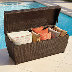 Frontgate - All-weather Wicker Outdoor Storage Chest - Small - Oversized trunk features a curved top that allows moisture to run off. Inner liner keeps cushions or beach equipment dry and mildew-free. Constructed of all-weather, uV-resistant wicker in bronze. Handwoven over an aluminum frame. Pneumatic hinges allow for smooth operation. Our All-weather Wicker Storage Chest is both durable and functional. Use it to store outdoor furniture cushions, garden necessities, and more in high style.  . . Constructed of all-weather, UV-resistant wicker in bronze. . . A Frontgate exclusive. Note: Not recommended for use with items that have been exposed to chlorine or other chemicals.