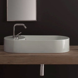 "Scarabeo - Elegant Oval Shaped White Ceramic Vessel Sink by Scarabeo - Designed and manufactured in Italy by Scarabeo. Elegant contemporary oval shaped washbasin made of high quality white ceramic. Above counter vessel sink includes overflow and a single faucet hole. Sink dimensions: 22.10"" (width), 5.30"" (height), 11.80"" (depth)"