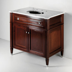 Regent Single Wood Vanity - Here is an elegant, furniture-quality vanity form Waterworks. I like the carved top, hardware and the mahogany finish for a special powder room.