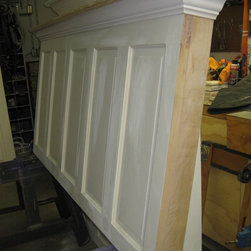 Headboards Made From Doors - Five panel vintage door converted into a headboard for a king size bed ready to be painted.