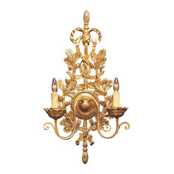 "Inviting Home - Northern Italian Sconce - Northern Italian style carved wood wall sconce in antiqued gold leaf; 13-1/2"" x 24-1/2""H ; hand-crafted in Italy; The overall silhouette of this elaborately designed carved wood wall sconce is immediately recognized as a Northern Italian style. The back of the wall sconce is richly embellished with uprising gracefully curved oak tree branches with acorns and adorned with bow-tided ribbon on the top. The elegantly scrolled hand wrought iron handles of the sconce support stylized candleholders and radiate from the round beaded center rosette. This wooden sconce is carved in great detail and deep relief providing a realistic appearance through play of shadows. Gorgeous antiqued finish with a crimson undertones that peek though finest quality expertly applied gold leaf adds charm and sense of history. UL approved - dry location; hardwire; 2x 60W max. candelabra bulds; bulbs not included. Handcrafted in italy."