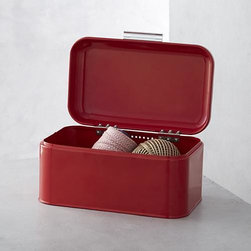"Polder® Metro Red Bin - Utilitarian-chic storage for any room in the house. Solid steel bin, with durable red powdercoat finish, charming ""loaf"" shape and bar handle, features a securely riveted lid that stands open at a 100-degree angle for easy access."