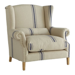 Grand Wingback Chair - This is the ultimate lounging chair. Its dimensions are wide and deep so you'll never stop finding comfortable positions to adjust in. The hemp upholstery is handsome and softens the size. If you thought you were going to get lost in your book, just wait until you have to try and pull yourself away from the comfort of this chair!