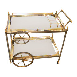 Brass and Nickle Tea/Bar Cart - Every good party should end with a champagne toast. Instead of gathering guests in another room, why not bring the champagne to them? This bar cart is a perfect way to do that. Plus, it looks beautiful in your home either empty or accessorized.