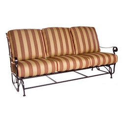O.W. Lee San Cristobal Wrought Iron Sofa Glider - You'll love gently gliding back and forth in the summer breeze blows as you relax on the O.W. Lee San Cristobal Sofa Glider A gorgeous addition to any porch, deck, or patio, this sofa glider is made from handcrafted wrought iron and is designed to embody the romance of the Spanish Baroque period. Perfect for sitting and relaxing, you'll love talking with friends or engaging your neighbors in conversation. You'll also love reading a book, watching your kids play, and even catching a quick nap while relaxing on this glider. Available with your choice of Sunbrella cushions so you can easily complement your existing decor, Sunbrella cushions are fade-, stain-, mildew-, and water-resistant, durable, easy to clean with mild soap and water, and includes a five year fade warranty. A beautiful combination of comfort, beauty, and durability, you'll having this glider as a part of your outdoor furniture decor.Materials and construction:Only the highest quality materials are used in the production of O.W. Lee Company's furniture. Carbon steel, galvanized steel, and 6061 alloy aluminum is meticulously chosen for superior strength as well as rust and corrosion resistance. All materials are individually measured and precision cut to ensure a smooth, and accurate fit. Steel and aluminum pieces are bent into perfect shapes, then hand-forged with a hammer and anvil, a process unchanged since blacksmiths in the middle ages.For the optimum strength of each piece, a full-circumference weld is applied wherever metal components intersect. This type of weld works to eliminate the possibility of moisture making its way into tube interiors or in a crevasse. The full-circumference weld guards against rust and corrosion. Finally, all welds are ground and sanded to create a seamless transition from one component to another.Each frame is blasted with tiny steel particles to remove dirt and oil from the manufacturing process, which is then followed by a 5-step wash and chemical treatment, resulting in the best possible surface for the final finish. A hand-applied zinc-rich epoxy primer is used to create a protective undercoat against oxidation. This prohibits rust from spreading and helps protect the final finish. Finally, a durable polyurethane top coating is hand-applied, and oven-cured to ensure a long lasting finish.About SunbrellaSunbrella has been the leader in performance fabrics for over 45 years. Impeccable quality, sophisticated styling and best-in-class warranties prove the new generation of Sunbrella offers more possibilities than ever. Sunbrella fabrics are breathable and water-repellant. If kept dry, they will not support the growth of mildew as natural fibers will. Beautiful and durable, Sunbrella is a name you can trust in your outdoor furniture.Cleaning and Caring for SunbrellaRegular maintenance is the best way to keep your Sunbrella fabrics looking good and delay deep, vigorous cleaning. Brush off dirt before it becomes embedded in the fabrics, and wipe up spills as soon as they occur. For light cleaning, use a mild soap and water solution and a sponge, allowing your cleaning solution to soak into the fabric. Rinse thoroughly to remove all soap residue and allow fabric to air dry.About O.W. Lee CompanyAn American family tradition, O.W. Lee Company has been dedicated to the design and production of fine, handcrafted casual furniture for over 60 years. From their manufacturing facility in Ontario, California, the O.W. Lee artisans combine centuries-old techniques with state-of-the-art equipment to produce beautiful casual furniture. What started in 1947 as a wrought-iron gate manufacturer for the luxurious estates of Southern California has evolved, three generations later, into a well-known and reputable manufacturer in the ever-growing casual furniture industry.