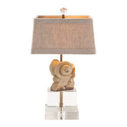 Hastings Painted Hand Carved Solid Wood Lamp - The Hastings Painted Hand Carved Solid Wood Lamp brings the sumptuous details of old-world European craftsmanship to your transitional decor. A petal base lends a slight touch of whimsy; the carved lamp base boasts a  coalescence of light and dark warm earth tones. With an added  slip of gold silk in the lamp shade trim,  this is an ideal lighting solution for the library, formal dining room, or great room.