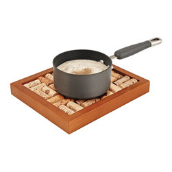 Wine Cork Trivet Kit - If you can measure your life in coffee spoons, why not measure life in glasses of wine? Remember every occasion you popped a cork by keeping each cork in this functional display.