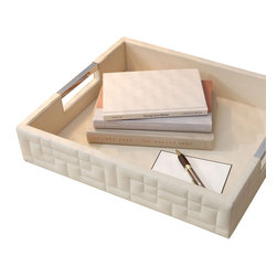 Quilted Ivory Leather Tray - An intriguing geometric design quilted into the outer walls softens the precision of the Quilted Ivory Leather Tray, a superb accent for the coffee table or office space that corrals its contents in a sleek space of pale, classic materials. Polished nickel bars level with the surface of the tray's rim serve as handles, adding another element of traditional, versatile design to the tray.