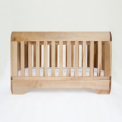"Kalon Studios - Kalon Studios | Echo Crib - Made in the U.S.A. by Kalon Studios.A striking balance between bold and delicate, the Echo Crib makes a beautiful focal point for the modern nursery. Sloping edges sculpted from solid maple, give this crib soft lines, while the sturdy construction provides generations of use. The adjustable mattress height, stationary sides, open space on each side, and the ability to convert the crib to a platform style toddler bed all contribute to the safety and longevity of this crib. The Echo Crib's beauty and practicality make it the ideal first addition to the modern nursery. Product Features:  Two-point adjustable mattress height Solid construction and stationary sides Open on all sides for 100% visibility Fits standard crib mattress 27.25""W X 51.6""L and 4quot;-6"" thick Converts to platform style toddler bed (no additional kit required) Converts to Echo Toddler Bed with optional conversion kit Made from FSC Certified Maple Mattress support made from Formaldehyde free FSC Baltic Birch multi-ply Propriety non-toxic, hand-mixed wood finish 100% non-toxic and/or food safe materials and finishes Certified, Low VOC, 100% HAPS (Hazardous Air Pollutants) Free Paint Conforms to ASTM, CPSC, and Health Canada regulations"