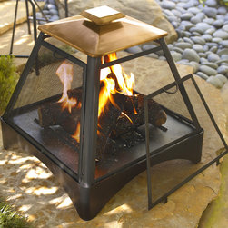 Pagoda Style Fire Pit with Copper Accent - Bring the blaze to your backyard with this pagoda style copper topped fire pit. The exterior steel grate is heavy duty without obstructing visibility or warmth, and the hinged door makes manipulating firewood and cleaning a breeze. Tend your fire simply and safely with the Pagoda style fire pit.