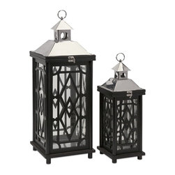 """IMAX CORPORATION - Arlington Wood Lanterns - Set of 2 - With expert styling, the beauty of the Arlington wood lanterns is in the details, such as the stainless steel top and handsome geometric wooden elements.  Set of 2 lanterns measuring 18.5""""H x 7""""W x 7""""L and 26""""H x 9.5""""W x 9.5""""L each. Find home furnishings, decor, and accessories from Posh Urban Furnishings. Beautiful, stylish furniture and decor that will brighten your home instantly. Shop modern, traditional, vintage, and world designs."""