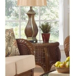 "Hospitality Rattan Turks Bay Full Frame Rattan & Wicker End Table - Antique - Nothing will be quite as nice as reaching out to set down a cool umbrella-drink and knowing that the Hospitality Rattan Turks Bay Full Frame Rattan & Wicker End Table - Antique is there to help you out. This tall end table is crafted from woven wicker that's supported by commercial-quality rattan poles with an antique finish. Woven Abaca rope surrounds the inset glass table top, and a beveled edge gives it a finished, elegant appearance. This piece easily coordinates with the rest of the Hospitality Rattan Turks Bay line, but it's also just fine by itself.About Hospitality RattanHospitality Rattan has been a leading manufacturer and distributor of contract quality rattan, wicker, and bamboo furnishings since 2000. The company's product lines have become dominant in the Casual Rattan, Wicker, and Outdoor Markets because of their quality construction, variety, and attractive design. Designed for buyers who appreciate upscale furniture with a tropical feel, Hospitality Rattan offers a range of indoor and outdoor collections featuring all-aluminum frames woven with Viro or Rehau synthetic wicker fiber that will not fade or crack when subjected to the elements. Hospitality Rattan furniture is manufactured to hospitality specifications and quality standards, which exceed the standards for residential use.Hospitality Rattan's Environmental CommitmentHospitality Rattan is continually looking for ways to limit their impact on the environment and is always trying to use the most environmentally friendly manufacturing techniques and materials possible. The company manufactures the highest quality furniture following sound and responsible environmental policies, with minimal impact on natural resources. Hospitality Rattan is also committed to achieving environmental best practices throughout its activity whenever this is practical and takes responsibility for the development and implementation of environmental best practices throughout all operations. Hospitality Rattan maintains a policy of continuous environmental improvement and therefore is a continuing work in progress.Hospitality Rattan's Environmentally Friendly Manufacturing ProcessAll of Hospitality Rattan products are green. From its basic raw materials of rattan poles, peels, leather, bamboo, abaca, lampacanay, wood, leather strips, and boards, down to other materials like nails, staples, water-based adhesives, finishes, stains, glazes and packing materials, all have minimum impact to the environment and are safe, biodegradable, recycled, and mostly recyclable. Aside from this, the products have undergone an environmentally-friendly process that makes them """"greener."""" The company's rattan components are sourced from sustained-yield managed forests, which means the methods used to grow and harvest the rattan vines ensure the long-term life of the forest and protect the biodiversity of the forest's ecosystems.Hospitality Rattan is committed to buying and using all materials, from rattan and hardwood to finishing materials, from reputable and renewable suppliers and seeks appropriate evidence that suppliers are in compliance with this policy. Hospitality Rattan strives to use materials that are processed in an environmentally responsible manner, or consist of a high level of recycled material. Finishing materials and stains used in Hospitality Rattan's furniture products consist of 75% water-based solutions which evaporate upon application with reduced or Volatile Organic Compounds (VOCs). The furniture factories use water-based glues, stains, topcoats and other finishes on all of their products. The switch from traditional solvent-based processes to water-based processes involved consolidating several processes by the factories, resulting in an 85% reduction in VOC emissions."