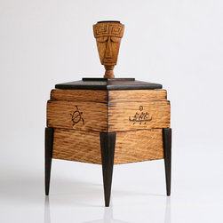 tiki box - This piece features a double face Tiki handle with an inlayed Ebony crown. All four sides of the White oak case has a Hawaiian style petroglyph carved into it. The Petroglyphs are hand carved then burnt in so they blend in with the lid and feet, that are made with exotic African wenge.