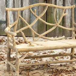 Woodland Bench - Whimsical and exquisite with its traditional Faux Bois technique of hand applied concrete over metal tubes, the Woodland Bench is lightweight and gives the appearance of being constructed of sticks and wood from an enchanted forest floor. Indoors or outdoors, this bench is a uniquely beautiful addition to any decor space.