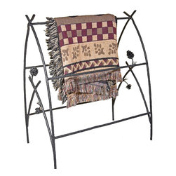 Mathews & Company - Piney Woods Blanket Stand - This beautiful wrought iron blanket stand not only stores your blankets when they aren't wrapped around you, it also shows them off with rustic charm. Featuring intricately handcrafted iron pine cones, the Piney Woods collection brings the majesty of the forest into your home. This hand welded stand comes in four striking finishes to perfectly match your personal style and home d̩cor: natural black, rust, aged pewter or aged bronze. Each piece is created individually by skilled artisan blacksmiths after you order it - no assembly line production here! Every bend and joint is painstakingly perfected for top quality, durability and beauty.