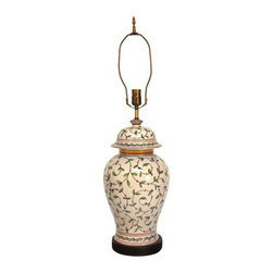 Pre-owned Vintage Chinese Ginger Lamp - A lovely vintage Chinese ginger jar lamp in traditional shape with leaves and vines decorating the exterior. Beautiful hand painted detail with red and yellow accents on top and bottom. Brass hardware and finial on top and sits on a solid wood base. In excellent condition.