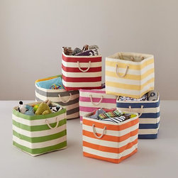 Stripes Around the Floor Bin - These striped bins are perfect for concealed storage. Fill them with toilet paper, washcloths and bath toys, and everything will fit in a tall, skinny shelf.