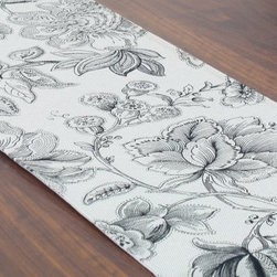 Chooty and Co Botany Black Table Runner - Delicately crafted of 100% pure cotton, the classic Chooty and Co Botany Black Table Runner features a traditional floral pattern in subtle shades of gray. Ideal for dressed-up dinners or daily fare, this handsome table runner adds a splash of style to your dining decor. Made in the USA. Hand-wash or spot-clean.About Chooty & Co.A lifelong dream of running a textile manufacturing business came to life in 2009 for Connie Garrett of Chooty & Co. This achievement was kicked off in September of '09 with the purchase of Blanket Barons, well known for their imported soft as mink baby blankets and equally alluring adult coverlets. Chooty's busy manufacturing facility, located in Council Bluffs, Iowa, utilizes a talented team to offer the blankets in many new fashion-forward patterns and solids. They've also added hundreds of Made in the USA textile products, including accent pillows, table linens, shower curtains, duvet sets, window curtains, and pet beds. Chooty & Co. operates on one simple principle: What is best for our customer is also best for our company.